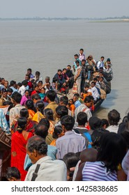 Sundarbans area, West Bengal/India – February 12 2012: Boat overloaded with people at the crossing.