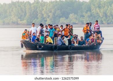 SUNDARBANS, BANGLADESH - NOVEMBER 14, 2016: Tourists on a boat during a Sundarbans tour, Bangladesh.