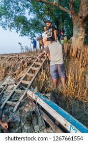 SUNDARBANS, BANGLADESH - NOVEMBER 14, 2016: Tourists enter their boat during a Sundarbans tour, Bangladesh.