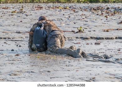 SUNDARBANS, BANGLADESH - NOVEMBER 14, 2016: Tourist in a muddy river coast during a Sundarbans tour, Bangladesh.