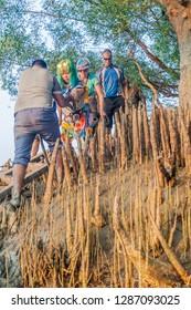 SUNDARBANS, BANGLADESH - NOVEMBER 14, 2016: Tourists in a mangrove forest of Sundarbans, Bangladesh.