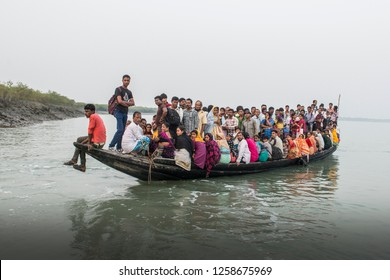 SUNDARBANS, WEST BENGAL, INDIA, 12-08-2015. small ferry in the Sundarbans packed with passengers