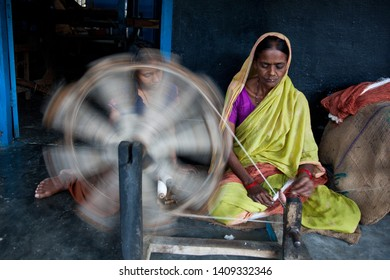 Sundarpur, India - 2011: Unidentified Indian leprosy patient working in the weaving workshop of a leprosy colony in Sundarpur, Bihar state, India