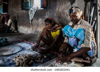 Sundarpur, India - 2013: Unidentified Indian leprosy patients working in the kitchen of a leprosy colony in Sundarpur, Bihar state, India
