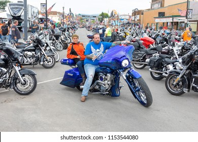 SUNDAY, AUGUST 5, 2018, STURGIS, SD: A man and woman prepare to roll out on their custom motorcycle at the annual Sturgis Motorcycle Rally.