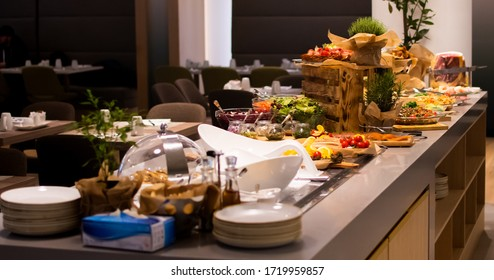 Sunday Brunch Menu with salads, meat, cheese cuts and vegetables during hotel brunch buffet indoor restaurant setting.