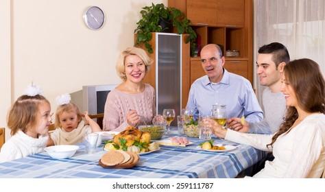 Sunday dinner in the bosom of happy family indoor
