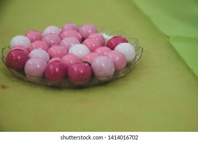 Sunday in an Italian restaurant. White and pink sugared almonds are served at the table for a birthday party
