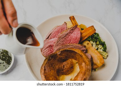 Sunday Roast Beef with Yorkshire Pudding, Roast Potatoes, Carrots, Parsnip, Broccoli and Gravy