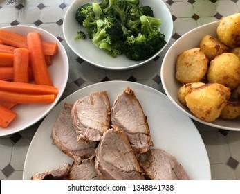 Sunday roast dinner with pork and vegetables