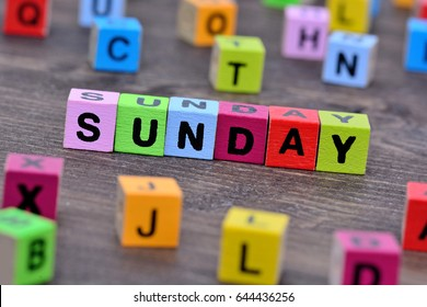 Sunday word on wooden table