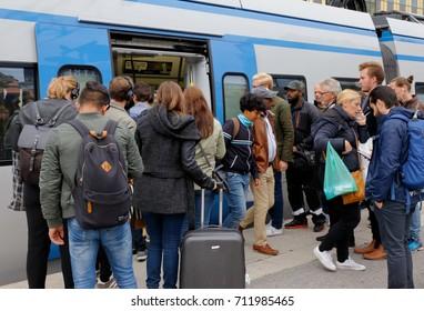 Sundbyberg, Sweden - September 8, 2017:  Commuter train in service Greater Stockholm public transportation at Sundbyberg station exchanges passengers.