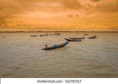 Sunderban, Bangladesh - circa July 2012: Photo of native people in wooden boats on river and fishing in Sunderban, Bangladesh. Documentary editorial.