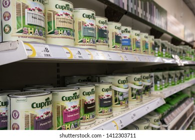 Sunderland - Great Britain / April 13, 2019 : Wilko Branded paint tin cans on display shelf for sale in shop