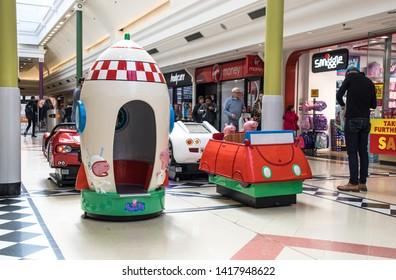 Sunderland - Great Britain / April 13, 2019 : Amusement rides for children in a modern shopping centrte mall