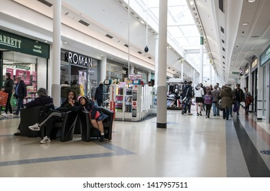 Sunderland - Great Britain / April 13, 2019 : Shoppers inside a modern shopping centre mall