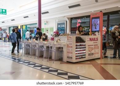 Sunderland - Great Britain / April 13, 2019 : Nail salon stand inside a modern shopping centre mall