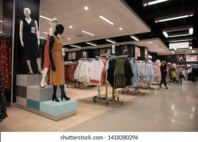 Sunderland - Great Britain / April 13, 2019 : Interior inside shop store display of fashion clothing with mannequins