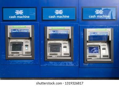 Sunderland / Great Britain - February 19, 2019: Exterior shot of three Halifax Bank Cash Machine atm.
