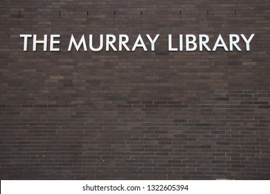 Sunderland / Great Britain - February 19, 2019: Exterior shot of The Murray Library, part of the University of Sunderland, signage on brick wall.