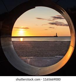 Sunderland lighthouse at sunrise in natural frame.