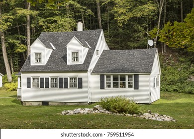 SUNDERLAND, USA - SEP 21, 2017: typical wooden small farm house in victorian style in Sunderland, Vermont, USA in the green mountain area.