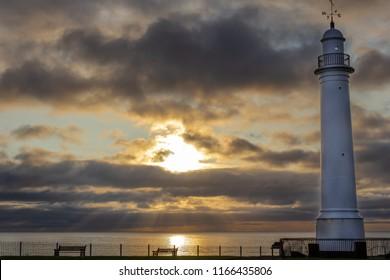 Sunderland white lighthouse during a very dramatic sunrise