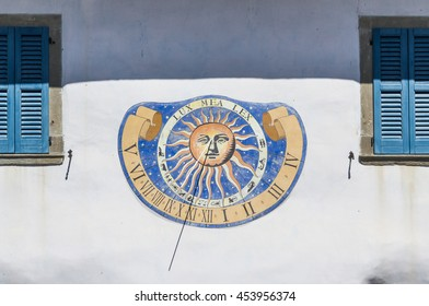 Sundial clock on old house wall in Italy - Riva di Solto -