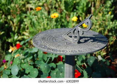 Sundial in a flower garden