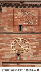 Sundial and mechnic clock on Basel Cathedral, which were built in different eras and maintained tradition, Switzerland