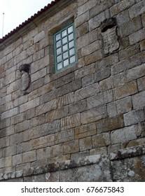 Sundial on a stone wall