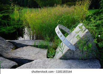 Sundial in the summer garden - sundial in the shape of the rim