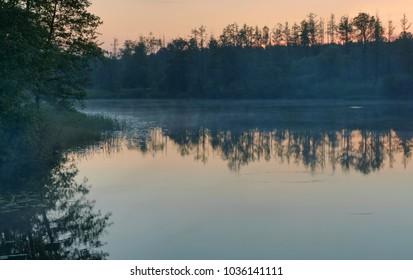 sundown by a lake