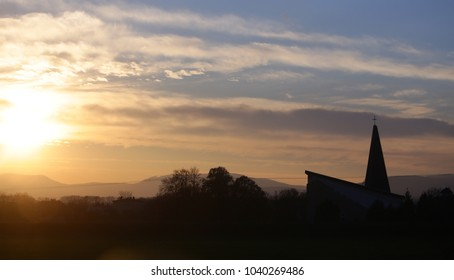 Sundown, cloudscape, nature, environment. Landscape and church, cross silhouette on cloudy sunset sky. Religion, faith, believe.