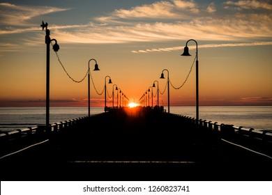 Sundown at the dock in the italian city Forte dei Marmi.
