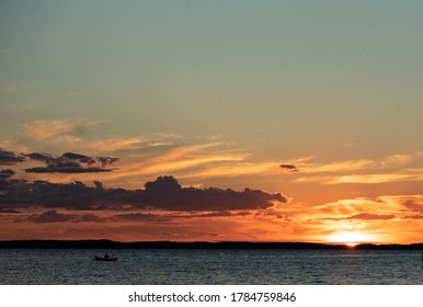 sundown at lake in middle finnland