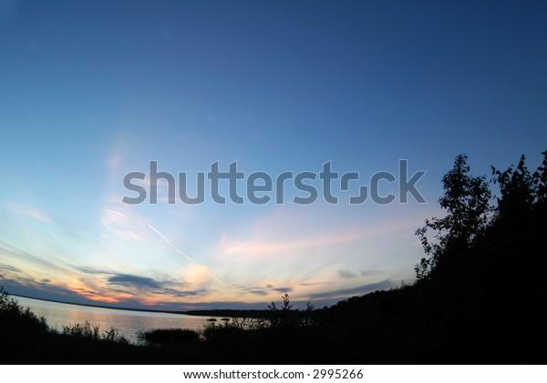 sundown on Lake in summertime