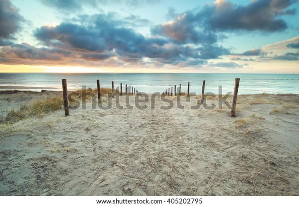 sundown over North sea sand beach, Zandvoort aan zee, Netherlands