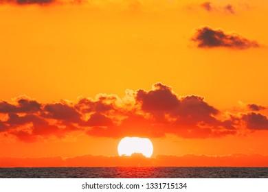 Sundown Over Sea Horizon At Sunset. Natural Sunrise Sky Warm Colors Over Ocean.