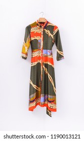 Sundress dress with a belt, fashion pattern. on hanging Isolate