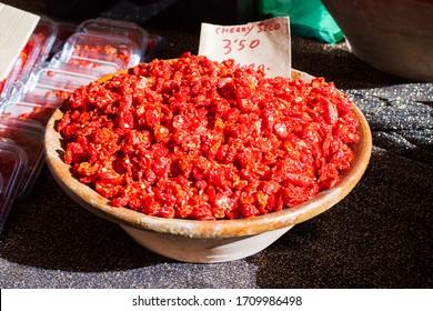 Sun-dried cherry tomatoes for sale on Porreres Market. Porreres, Majorca, Spain