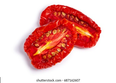 Sundried or dried tomato halves, top view. Clipping paths, shadow separated