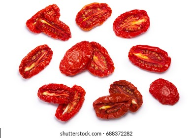 Sundried or dried tomato halves, top view, singles and pairs. Clipping paths, shadow separated