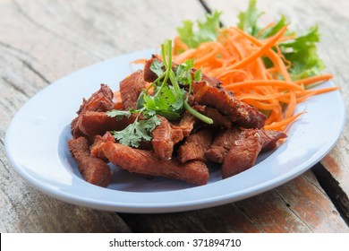 Sun-dried pork grill with carrot topping