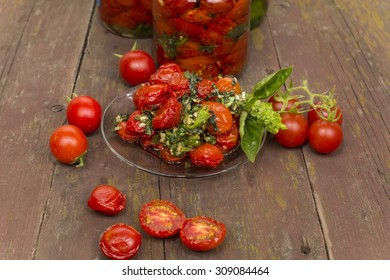sun-dried tomatoes cherry varieties on a glass saucer