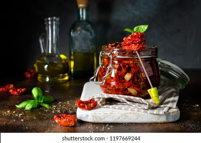 Sun-dried tomatoes with olive oil in a jar. Step by step cooking