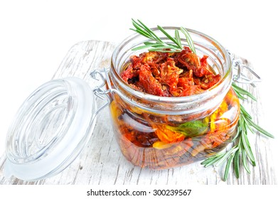 Sun-dried tomatoes with rosemary, olive oil and garlic in a glass jar