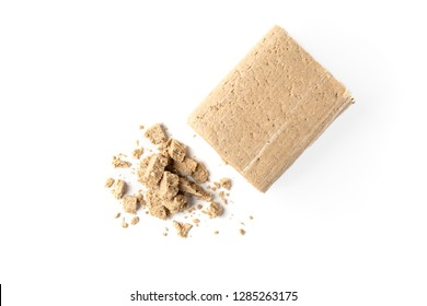 Sunflower halva isolated on white background.