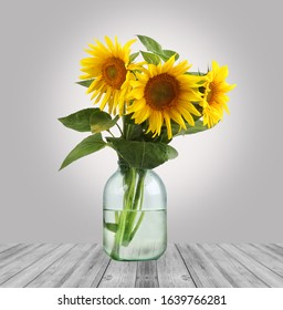 sunflower in a jar on the table