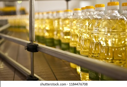 Sunflower oil in the bottle moving on production line. Shallow dof.